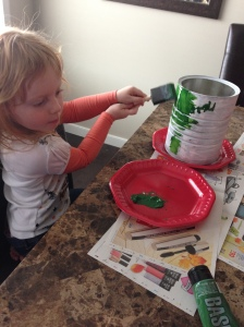 My oldest daughter painting hers.